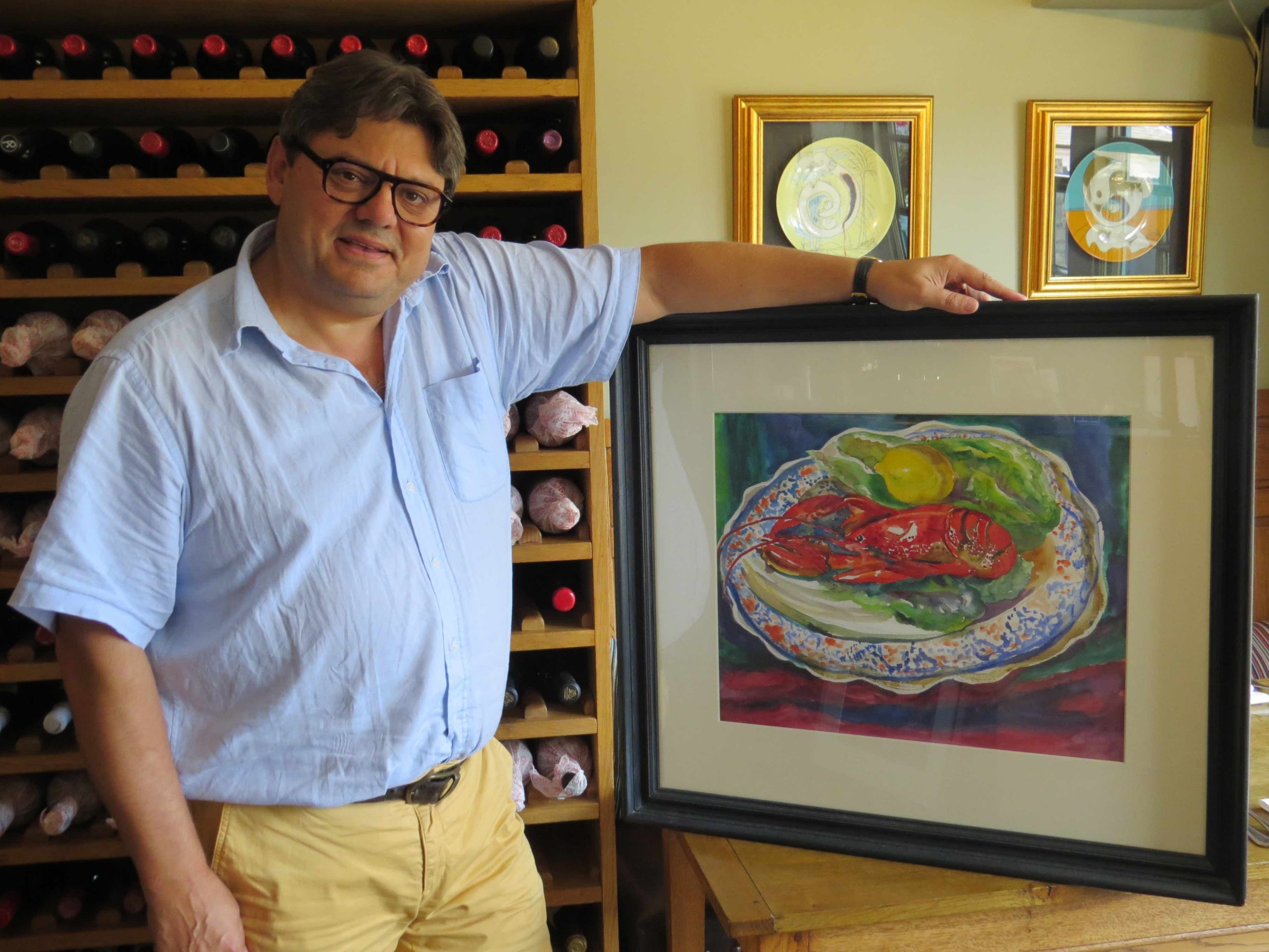Ugur Vata and his lobster painting by Colin Moss